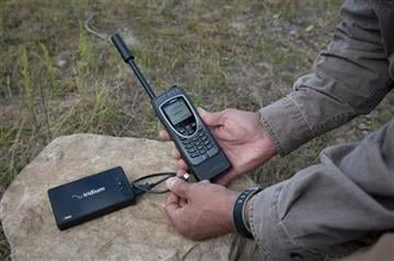 This undated photo provided by Iridium Communications Inc., shows the Iridium AxcessPoint and the Iridium Extreme satellite phone. (AP Photo/Iridium Communications Inc.) By Belo Content KMOV