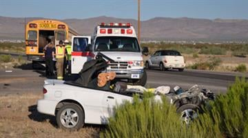 One person is dead after a school bus and a car collided in Golden Valley west of Kingman Tuesday morning. By Jennifer Thomas
