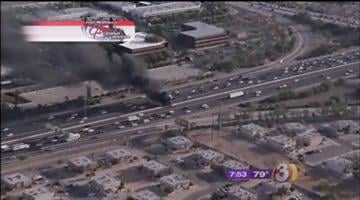 """A """"dually"""" truck caught fire on eastbound Interstate 10 near State Route 143 Tuesday morning.Aerial video from the scene showed the  big silver pickup truck fully engulfed in flames. By Catherine Holland"""