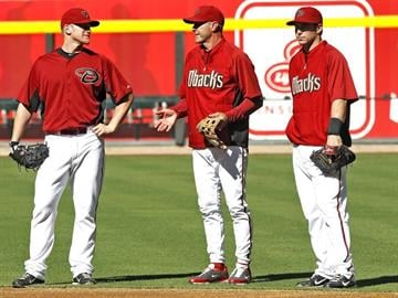 Arizona Diamondbacks head coach Kirk Gibson center talks with first baseman Paul Goldschmidt right and Lyle Overbay during the Diamondbacks team workouts Monday Oct. 3, 2011 in Phoenix. By Catherine Holland