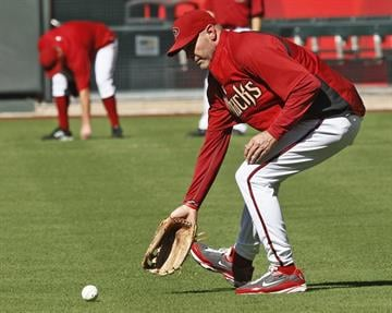 Arizona Diamondbacks head coach Kirk Gibson fields a ground ball during the Diamondbacks team workouts Monday, Oct. 3, 2011 in Phoenix. By Catherine Holland