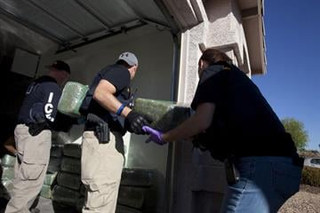 ICE HSI agents seize more than 800 pounds of marijuana from a house near 107th Avenue and Indian School Road. By Jennifer Thomas