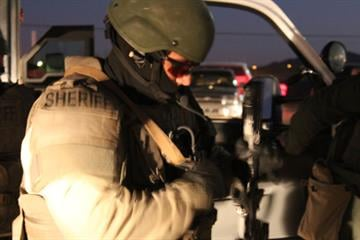 The Pinal County Sheriff's Office SWAT and Tactical Unit prepare to execute search warrants in Casa Grande. By Jennifer Thomas