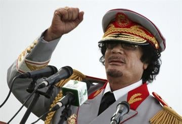 In this Saturday, June 12, 2010 file photo, Libyan leader Moammar Gadhafi talks during a ceremony to mark the 40th anniversary of the evacuation of the American militaryy bases in the country, in Tripoli, Libya. By Catherine Holland