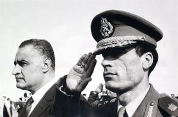 In this undated 1969 photo, Col. Moammar Gadhafi , right, salutes as he appears with Egypt's Prime Minister Gamal Abdel Nasser, left, in Suez, Egypt. By Catherine Holland