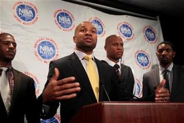 Derek Fisher, center, speaks during a news conference following NBA basketball labor talks on Thursday, Oct. 20, 2011, in New York. From left, Chris Paul, Maurice Evans and Roger Mason Jr. look on.(AP Photo/Frank Franklin II) By Frank Franklin II