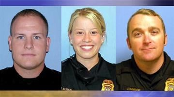 Officers John Rebholz, Michelle Burks and John Davidge By Catherine Holland
