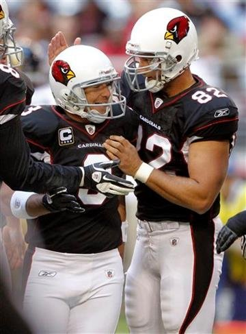 Arizona Cardinals kicker Jay Feely (3) celebrates his field goal with teammate  Mike Leach (82) during the first quarter of an NFL football game against the St. Louis Rams Sunday, Nov. 6, 2011, in Glendale, Ariz. (AP Photo/Paul Connors) By Paul Connors