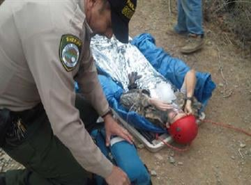 PCSO deputy Stinson administers first aid to the injured boy. By Jennifer Thomas