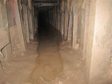The tunnel is approximately 20 feet below the surface and measures 3 feet wide by 2 feet tall. By Jennifer Thomas