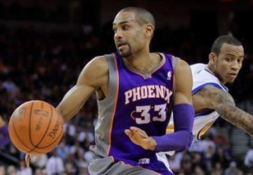 Phoenix Suns' Grant Hill, left, drives the ball past Golden State Warriors' Monta Ellis during the first half of an NBA basketball game Monday, Feb. 7, 2011, in Oakland, Calif. (AP Photo/Ben Margot) By Ben Margot
