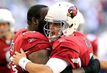 Arizona Cardinals' Kevin Kolb, right gets a hug from teammate Jeremy Bridges prior to an NFL football game against the Dallas Cowboys, Sunday, Dec. 4, 2011, in Glendale, Ariz. (AP Photo/Ross D. Franklin) By Ross D. Franklin