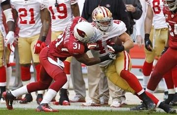 Arizona Cardinals' Richard Marshall (31) tackles San Francisco 49ers' Bruce Miller during the first quarter in an NFL football game, Sunday, Dec. 11, 2011, in Glendale, Ariz.(AP Photo/Ross D. Franklin) By Ross D. Franklin