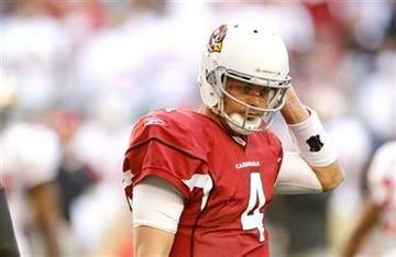 Arizona Cardinals' Kevin Kolb walks off the field after being knocked to the ground by San Francisco 49ers' Justin Smith during the first quarter in an NFL football game, Sunday, Dec. 11, 2011, in Glendale, Ariz.(AP Photo/Paul Connors) By Paul Connors