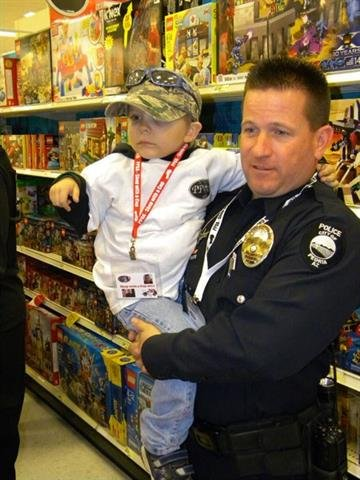 Officer Brendan Austin with Timmy Stangler By Jennifer Thomas