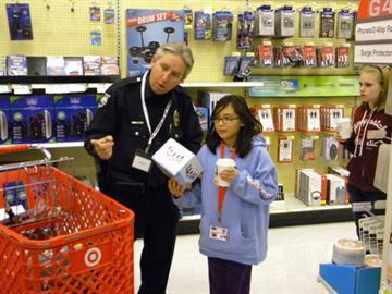 Detective David Hickman with Cindy Villanueva By Jennifer Thomas