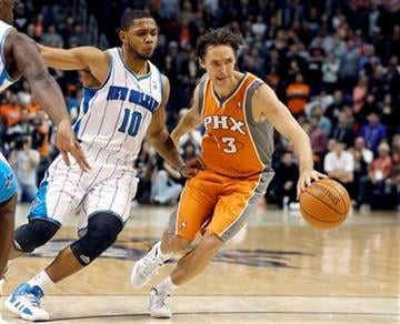 Phoenix Suns guard Steve Nash, right, dribbles away from New Orleans Hornets guard Eric Gordon, left, in the fourth quarter of an NBA basketball game, Monday, Dec. 26, 2011, in Phoenix. The Hornets won 85-84. (AP Photo/Paul Connors) By Paul Connors