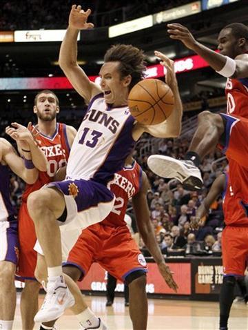 Phoenix Suns' Steve Nash (13) is fouled by Philadelphia 76ers' Jodie Meeks, right, during the third quarter of an NBA basketball game on Wednesday, Dec. 28, 2011, in Phoenix. (AP Photo/Matt York) By Matt York