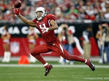 Arizona Cardinals wide receiver Larry Fitzgerald (11) pulls in a one-handed pass against the Seattle Seahawks during the second half of an NFL football game on Sunday, Jan. 1, 2012, in Tempe, Ariz. By Catherine Holland