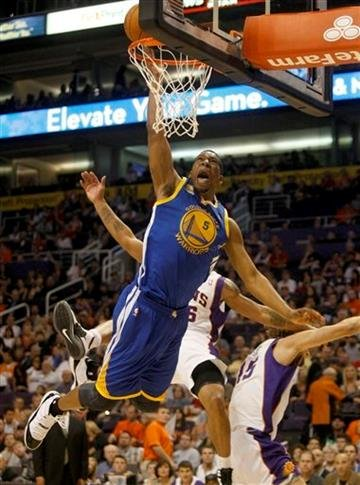 Golden State Warriors forward Dominic McGuire dunks over the Phoenix Suns during the first quarter of an NBA basketball game on Monday, Jan. 2, 2012, in Phoenix.  (AP Photo/Rick Scuteri) By Rick Scuteri