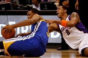 Golden State Warriors forward Dominic McGuire, left, and Phoenix Suns center Channing Frye scrap for the ball during the first quarter of an NBA basketball game Monday, Jan. 2, 2012, in Phoenix. (AP Photo/Rick Scuteri) By Rick Scuteri
