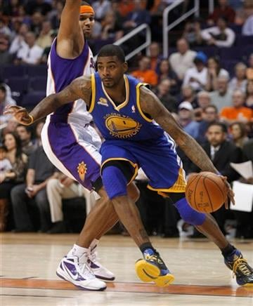 Golden State Warriors forward Dorell Wright, right, drives on Phoenix Suns forward Jared Dudley during the first quarter of an NBA basketball game Monday, Jan. 2, 2012, in Phoenix. (AP Photo/Rick Scuteri) By Rick Scuteri
