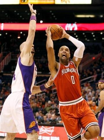 Milwaukee Bucks center Drew Gooden, right, drives around Phoenix Suns center Marcin Gortat, left, of Poland, on his way to the basket in the first quarter of an NBA basketball game, Sunday, Jan. 8, 2012, in Phoenix. (AP Photo/Paul Connors) By PAUL CONNORS