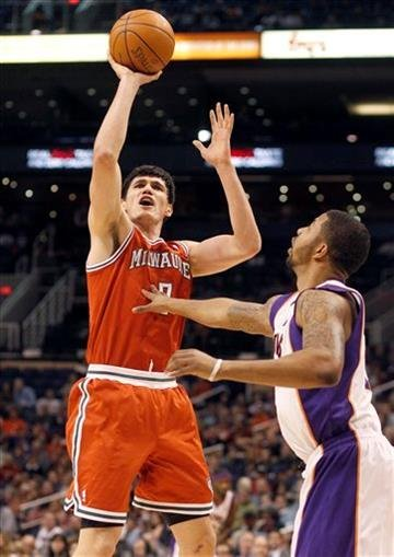 Milwaukee Bucks forward Ersan Ilyasova, left, of Turkey, shoots over Phoenix Suns forward Markieff Morris, right, in the first quarter of an NBA basketball game, Sunday, Jan. 8, 2012, in Phoenix. (AP Photo/Paul Connors) By PAUL CONNORS