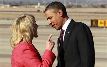 Arizona Gov. Jan Brewer has an intense conversation with President Barack Obama after he arrived at Phoenix-Mesa Gateway Airport in Mesa on Jan. 25, 2012. By Catherine Holland