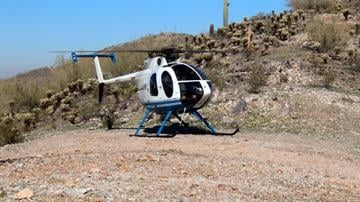 PCSO MD 500E taking off from a hill top outside Casa Grande By Mike Gertzman