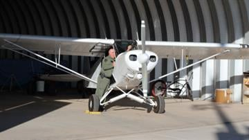 Lt. Scott Elliott pictured prior to a flight in the 1976 Piper Super Cub By Mike Gertzman