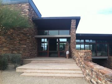 The front entrance with stone steps, brick walls and a lot of windows By Mike Gertzman