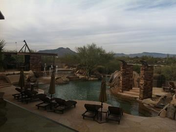 A swimming pool and fire pit which resembles some of the outdoor areas at the valley's finest resorts By Mike Gertzman