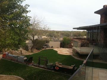 A view of the backyard where you can see the train By Mike Gertzman