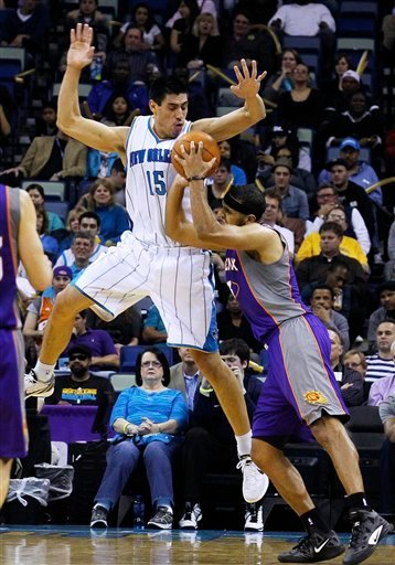 New Orleans Hornets forward Gustavo Ayon (15) runs into Phoenix Suns forward Jared Dudley (3) in the first half of an NBA basketball game in New Orleans, Wednesday, Feb. 1, 2012. Ayon was called for a foul. (AP Photo/Bill Haber) By Bill Haber
