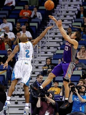 Phoenix Suns guard Streve Nash (13)shoots over New Orleans Hornets guard Jarrett Jack (2) in the first half of an NBA basketball game in New Orleans, Wednesday, Feb. 1, 2012.  (AP Photo/Bill Haber) By Bill Haber