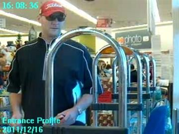 Surveillance picture of a suspect in a store where police say he used a credit card stolen from a teacher's purse while she was out of the classroom during recess. By Mike Gertzman