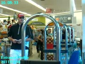 Surveillance picture of suspect in a store where police say he used a credit card stolen from a teacher's purse while she was out of the classroom during recess. By Mike Gertzman