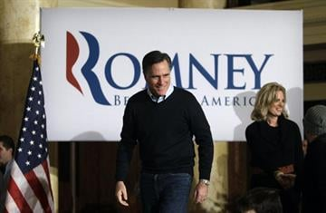 Republican presidential candidate, former Massachusetts Gov. Mitt Romney and his wife Ann, enter a caucus day rally at the Temple for Performing Arts, Tuesday, Jan. 3, 2012, in Des Moines, Iowa. (AP Photo/Charlie Neibergall) By Charlie Neibergall