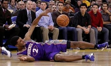 Phoenix Suns' Ronnie Price (2) struggles to keep the ball during the second half of an NBA basketball game against the Golden State Warriors Monday, Feb. 13, 2012, in Oakland, Calif. Warriors won 102-96.  (AP Photo/Ben Margot) By Ben Margot