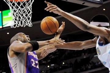 Phoenix Suns guard Michael Redd (22) loses control of the ball under pressure from Denver Nuggets forward Corey Brewer (13) during the first quarter of an NBA basketball game on Tuesday, Feb. 14, 2012, in Denver. (AP Photo/Jack Dempsey) By Jack Dempsey