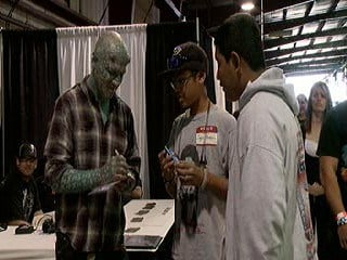 """""""The Enigma"""" signs an autograph at the Body Art Expo in Phoenix By Mike Gertzman"""