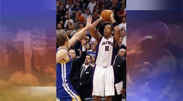 Phoenix Suns forward Channing Frye shoots a 3-point basket at the buzzer over Golden State Warriors forward David Lee, left, in the fourth quarter of an NBA basketball game Wednesday, Feb. 22, 2012, in Phoenix. By Jennifer Thomas