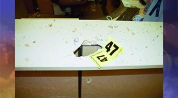 This photo depicts the force of the package bomb when opened by Don Logan. By Jennifer Thomas