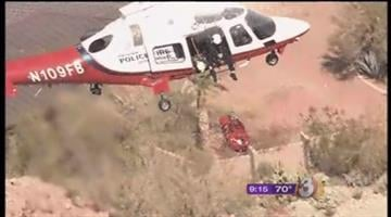 Rescuers use a helicopter to lift a hiker with a medical condition off Camelback Mountain By Mike Gertzman