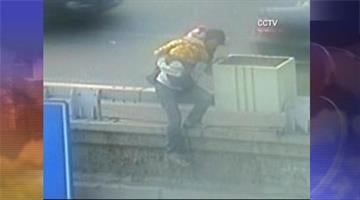 Police officer in Beijing, China stops woman from jumping off bridge By Mike Gertzman