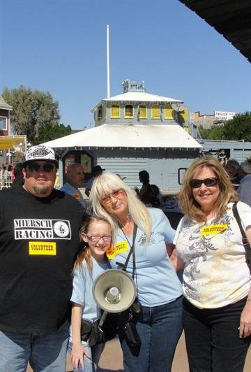 Organizer Julie Cameron with her granddaughter. More than 1,000 people gathered in Lake Havasu City, Ariz. over the weekend trying to set a world record for line dancing on the London Bridge. By Mike Gertzman