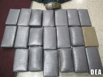 """To date, """"Operation Smoke in Glass"""" has resulted in the seizure of 128 pounds of methamphetamine, 33 kilograms of cocaine and 10 pounds of heroin. Agents also seized close to $300,000 in U.S. currency. By Jennifer Thomas"""