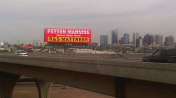 A billboard advertising mattresses over Interstate 10 asked Peyton Manning to lay his head in in the Valley. By Jennifer Thomas