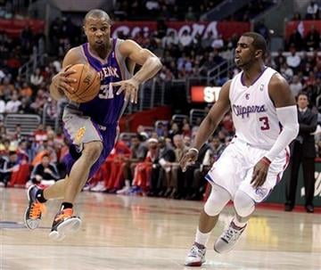 Phoenix Suns' Sebastian Telfair, left, drives past Los Angeles Clippers' Chris Paul during the first half of an NBA basketball game in Los Angeles, Thursday, March 15, 2012. (AP Photo/Jae C. Hong) By Jae C. Hong